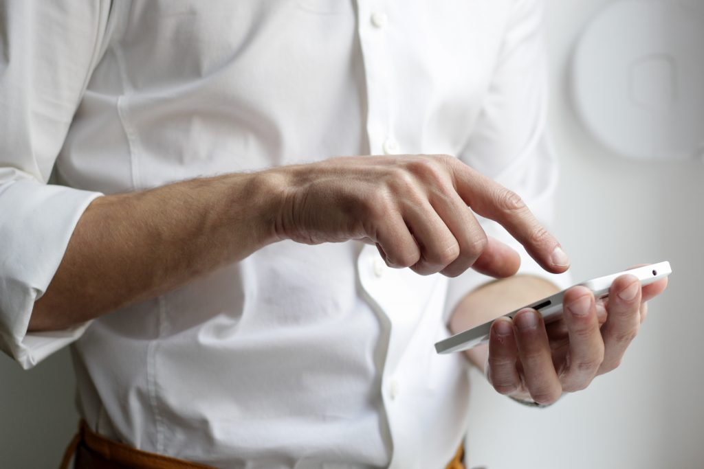 man using cell phone - patient pipeline