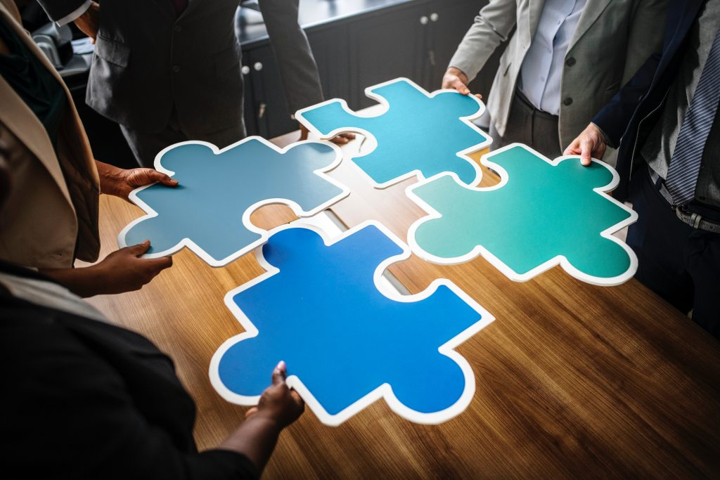 group holding puzzle pieces together - patient pipeline